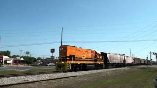 Bayline railroad local manifest train heads through Panama City Florida.