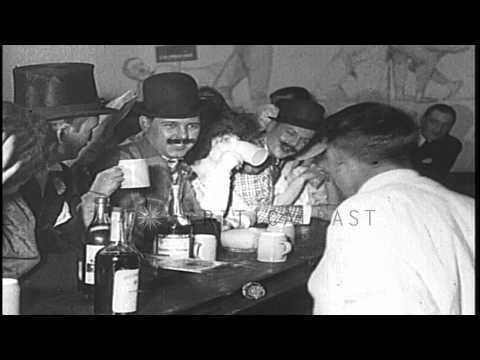 During Prohibition in the United States, men and women sit at a speakeasy bar and...HD Stock Footage
