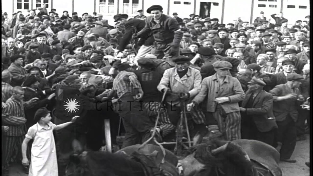 Inmates Of A Concentration Camp Try To Get Food In