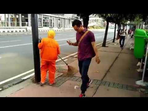 Hard Working Woman  -  The road sweeper job in Jakarta