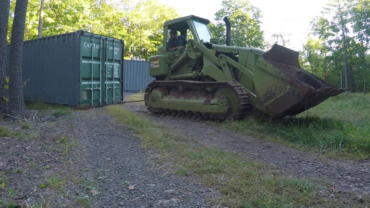Track Loader For Sale >> Dragging shipping containers up a hill - YouTube