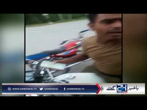 Police personnel caught selling alcohol to citizen in Lahore