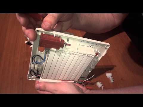 Look Inside A Broken Bathroom Fan With Built-in Timer And Shutter.