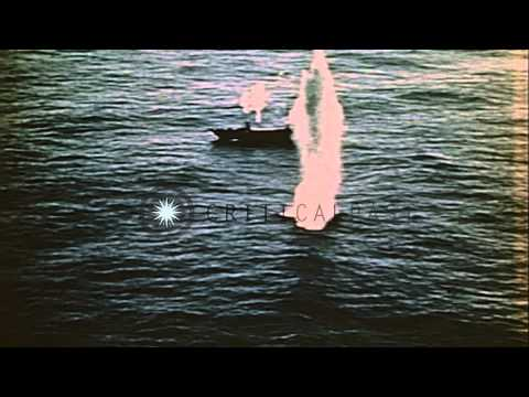 A merchant ship underway and is hit by rockets and machine gun in the Pacific Oce...HD Stock Footage