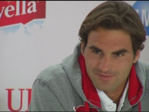 Roger Federer stoic after his shock defeat against Andy Murray at London 2012