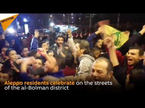 Residents Celebrate The Syrian Army's  Victory In Aleppo