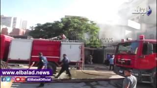 بالفيديو.. حريق بمحل تجاري بالقرب من بنك التنمية بالفيوم