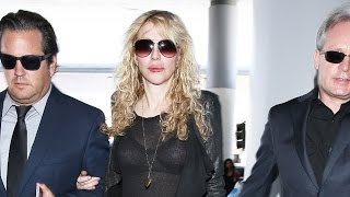 Courtney Love, Arriving at LAX in Designer Outfit, Tells Pap