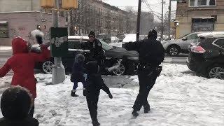 Watch NYPD Officers Get Into Snowball Fight With Kids During Snowstorm