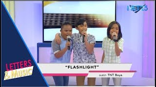 TNT BOYS FLASHLIGHT NET25 LETTERS AND MUSIC