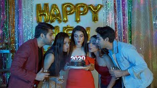 Happy group of young friends celebrating New Year Eve together - party concept
