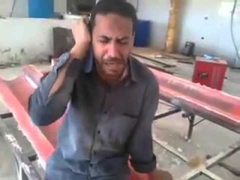 an a Egyptian  worker Arabian on work time Qur'an Recitation  MashaALLAH