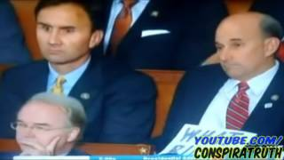 Reptilian shape shifting while obama talks   Caught on Tape   TV Cam