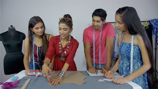 Young successful designer explaining pattern marking to her students