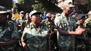 Close up of military veterans singing and marching. Membe...