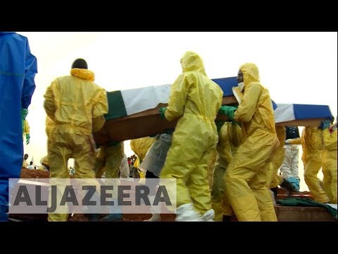 Mass burials held in Sierra Leone for mudslide victims
