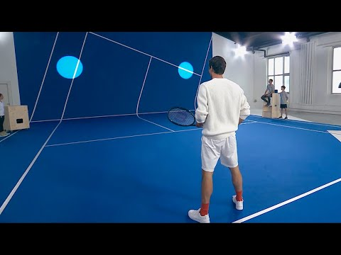 Roger Federer takes on fans in an interactive game of virtual tennis