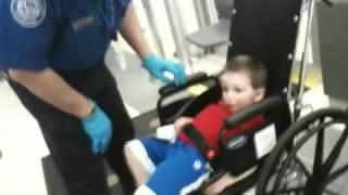 His first TSA Body Cavity Search, Awwww...!!!