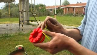 Cómo poner la tanza  a una bordadora.