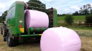 In the pink - wrapping hay bales