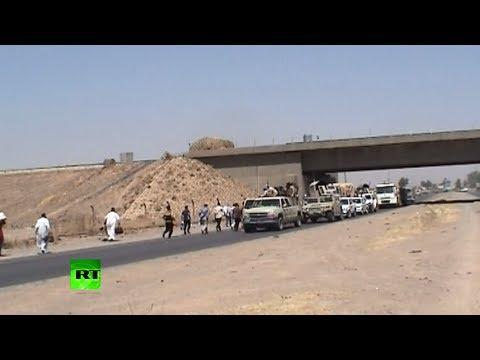 Radical Raid: Iraqi troops, civilians flee as militants take control of cities