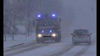 Einsatzfahrt FFW Heide und (RKISH) im Schneetreiben Zu einem Großfeuer
