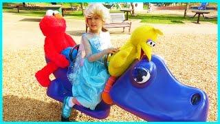 sesame street elmo big bird disney frozen elsa at playground auld lang syne nursery rhymes songs
