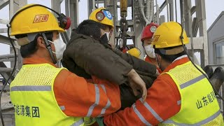 video: Eleven trapped miners rescued from Chinese mine after two weeks
