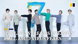 Baixar K-pop group BTS live-streams press conference in empty hall amid coronavirus epidemic