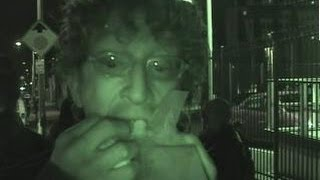 ANDY DICK amuses while eating hot dog