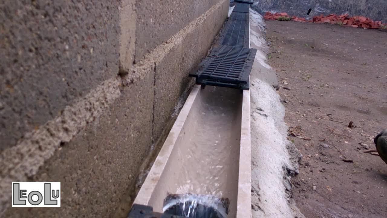 pose de caniveaux en beton polymere