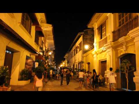 Walking along Calle Crisologo at Night