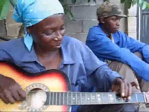 Игра на гитара (Африка)