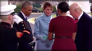WHAT MICHELLE OBAMA DOES RIGHT AFTER MELANIA HANDS HER A GIFT INSTANTLY GRABS PEOPLE'S ATTENTION