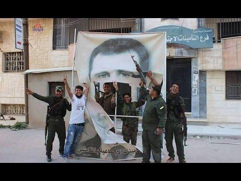 معارك دموية بالقامشلي..قصف أحيائها بالمدفعية..اقتحام لسجون النظام ومقراته..وتمزيق لصور الأسد-تفاصيل