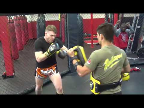 Ryan Cafaro holding Pads for Paul Felder
