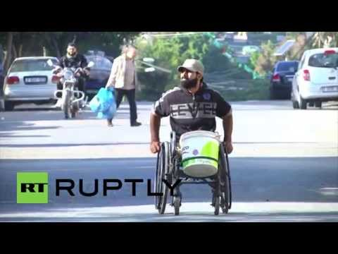 State of Palestine: Double amputee war casualty cleans cars to support family