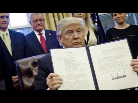 Why Iraq was removed from the revised travel ban