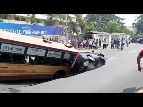 சென்னையில் திடீர் பள்ளத்தில் சிக்கிய கார், பேருந்து - Huge cave-in on popular Mount Road in Chennai swallows bus, car