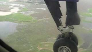 Touchdown - landing gear view - GMG Airlines DHC-8 Dash 8