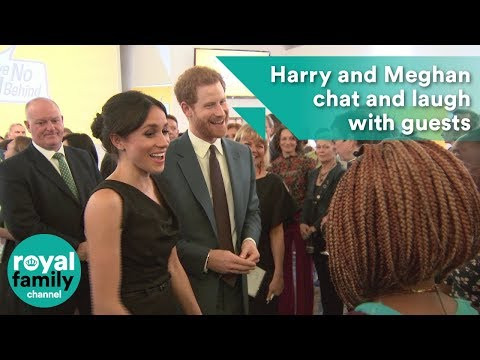 Prince Harry and Meghan chat and laugh with guests at women's empowerment event