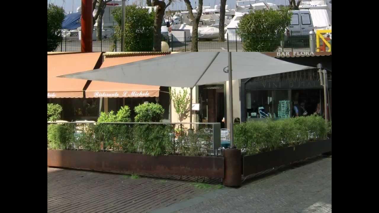 Toldo vela enrollable gennius sunrise con motor youtube for Toldos de vela para terrazas