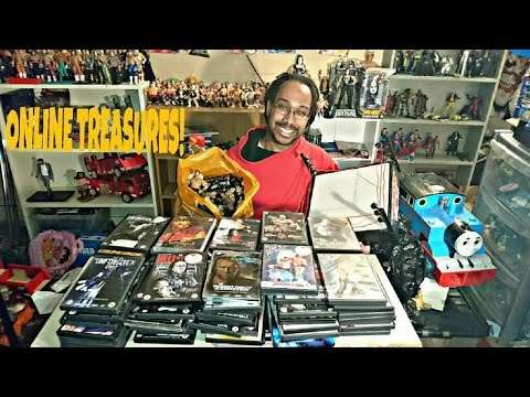 ONLINE TREASURES MEGA HAUL OF WWE DVDS AND WRESTLING FIGURES