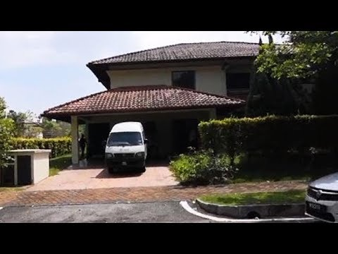 Cops raid bungalow in Putrajaya linked to Najib