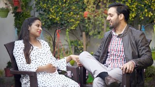 Pregnant Indian couple having a good time together while sitting outdoors