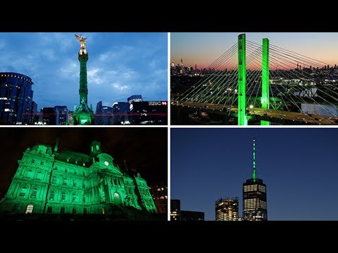 Landmarks around the world light up green in protest over Donald Trump pulling out of Paris accord