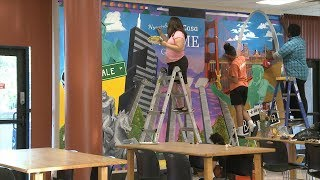 CARE Interns Paint New Mural at Oak Towers