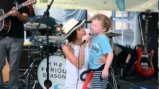 The Riches star Minnie Driver is seen holding the microphone for her 4-year-old son