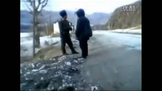 North Korean Soldiers Beat Man on the Street