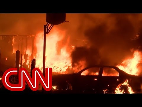 Massive California fire jumps over river and roars into city of 95,000 people